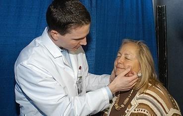 Dermatologist examining a women's face