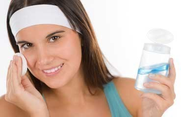 teen girl cleansing face
