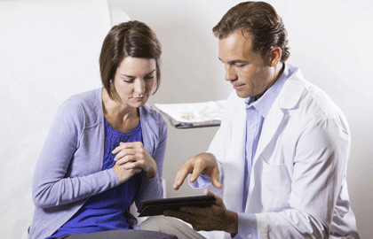 types-of-psoriasis-patient-with-dermatologist.jpg