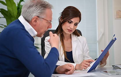 doctor-reviewing-medical-information-with-patient.jpg