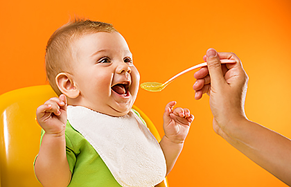 feeding-baby-food-with-peanuts.jpg