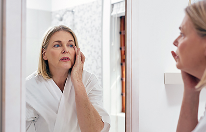 woman-examining-skin-during-menopause.jpg